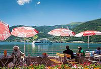 Oesterreich, Salzburger Land, Thumersbach: Cafe am See mit Blick auf Zell am See und die Schmittenhoehe | Austria, Salzburger Land, Thumersbach: cafe at Zeller Lake with towards Zell am See