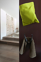 A pair of horns on the back of the bathroom door is used as a hook in the en suite bathroom of a contemporary bedroom