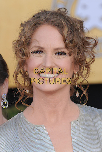 MELISSA LEO .at the 17th Screen Actors Guild Awards held at The Shrine Auditorium in Los Angeles, California, USA, .January 30th 2011..SAG Sags arrivals portrait headshot smiling hair up  metallic gold shiny  silver .CAP/RKE/DVS.©DVS/RockinExposures/Capital Pictures.
