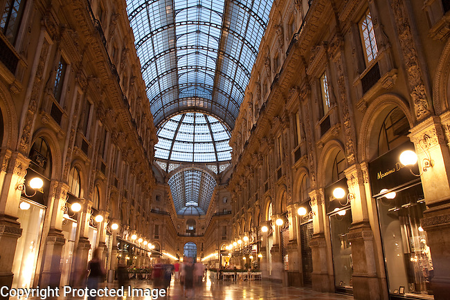 The Vittorio Emanuele II Shopping Gallery in Milan, Italy illuminated at night