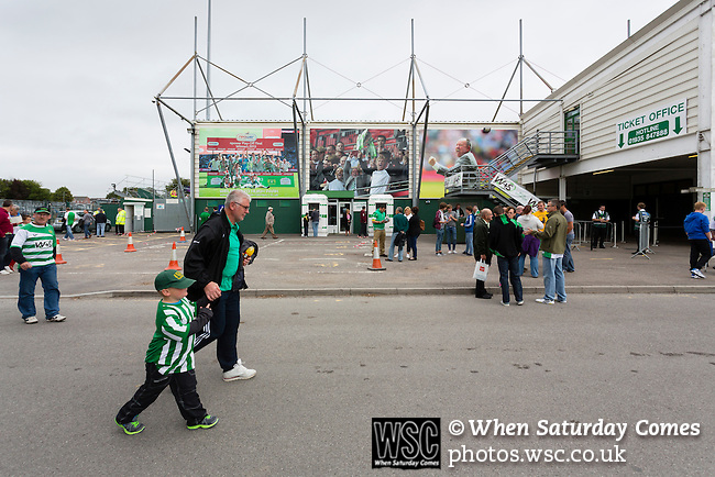 Yeovil Town 0 Queens Park Rangers 1, 21/09/2013. Huish Park, Championship. Fans walking past photographs of Yeovils 2013 play off win on the Augusta Westland Stand. Photo by Paul Thompson.