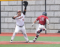 RICK PECK/SPECIAL TO MCDONALD COUNTY PRESS McDonald County first baseman Omar Manuel stretches for a high throw to just nip Joplin's Luke Benfield during the Eagles' 6-1 win in the Missouri Class 5 District 11 Baseball Tournament on May 11 at Joplin High School.