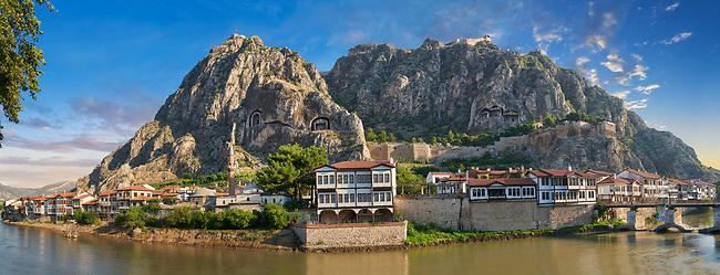 Ottoman villas of Amasya along the banks of the river Yeşilırmak, below the Pontic Royal rock tombs and mountain top ancient citadel at sunrise, Turkey