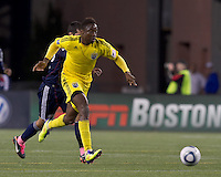 Columbus Crew midfielder Emmanuel Ekpo (17) dribbles as New England Revolution midfielder Benny Feilhaber (22) defends. In a Major League Soccer (MLS) match, the Columbus Crew defeated the New England Revolution, 3-0, at Gillette Stadium on October 15, 2011.
