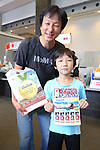 A boy shows commemorative stamps celebrating Japan's first gold medal of the Rio 2016 Olympics at the Tokyo Central Post Office in Tokyo, Japan on August 8, 2016. Japanese swimmer Kosuke Hagino won the gold medal in the men's 400m individual medley. (Photo by AFLO)