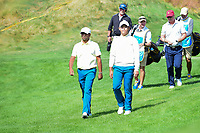 Anirban Lahiri (IND) and Si Woo Kim (KOR) depart the 4th tee during round 3 Four-Ball of the 2017 President's Cup, Liberty National Golf Club, Jersey City, New Jersey, USA. 9/30/2017.<br /> Picture: Golffile | Ken Murray<br /> <br /> All photo usage must carry mandatory copyright credit (&copy; Golffile | Ken Murray)