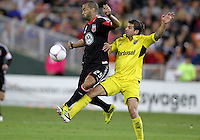 WASHINGTON, DC - OCTOBER 20, 2012:  Maicon Santos (29) of D.C United gets the ball away from Carlos Mendes (4) of the Columbus Crew during an MLS match at RFK Stadium in Washington D.C. on October 20. D.C United won 3-2.
