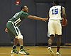 Tyler Small #32 of Holy Trinity, left, guards Lykeem Bethea #15 of Hempstead during a varsity boys' basketball game at Baldwin High School on Tuesday, Dec. 29, 2015. Holy Trinity won by a score of 70-58.