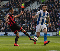 Bournemouth's Callum Wilson (left) crosses the ball despite the attentions of Brighton & Hove Albion's Shane Duffy<br /> <br /> Photographer David Horton/CameraSport<br /> <br /> The Premier League - Brighton and Hove Albion v Bournemouth - Saturday 13th April 2019 - The Amex Stadium - Brighton<br /> <br /> World Copyright © 2019 CameraSport. All rights reserved. 43 Linden Ave. Countesthorpe. Leicester. England. LE8 5PG - Tel: +44 (0) 116 277 4147 - admin@camerasport.com - www.camerasport.com