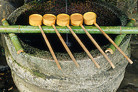 A basin with dippers waits for  Shinto pilgrims to stop for a ritual wash or for a sip to honor the spirits, or kami.