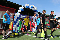 Referee, Dean Whitestone, leads out the two teams during Woking vs Watford, Friendly Match Football at The Laithwaite Community Stadium on 8th July 2017