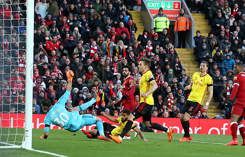 17th March 2018, Anfield, Liverpool, England; EPL Premier League football, Liverpool versus Watford;  Mohammed Salah of Liverpool beats Orestis Karnezis of Watford to score the opening goal after 4 minutes