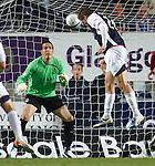Falkirk striker Kjartan Finnbogason sees his header saved by Jamie Langfield
