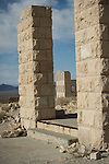 Ghost town of Rhyolite, Nevada<br /> <br /> Overbury Bank ruins pillars frame the old 8-room schoolhouse