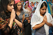Gursiman S Mehmi prays during the gathering at the Sikh Gurudwara of North Carolina in Durham to honor the victims of the Oak Creek shooting on Wednesday August 8th 2012.