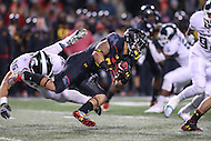College Park, MD - October 22, 2016: Maryland Terrapins running back Lorenzo Harrison (23) gets tackled by Michigan State Spartans defender during game between Michigan St. and Maryland at  Capital One Field at Maryland Stadium in College Park, MD.  (Photo by Elliott Brown/Media Images International)
