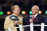 Former Pittsburgh Steelers quarterback and Fox Sports analyst Terry Bradshaw speaks to the crowd as former Dallas Cowboys quarterback Roger Staubach holds the Vince Lombardi Trophy during Super Bowl XLV on Sunday, February 6, 2011, in Arlington, Texas. The Packers won 31-25. (AP Photo/David Stluka)