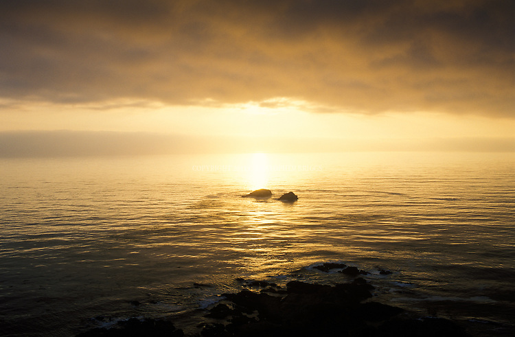 Sunset over Pacific Ocean from Garrapata State Park along Highway 1 and the Big Sur Coast. 3,000 acres (1,214ha). Park has two miles of beach front, coastal hiking and a 50-foot climb to a beautiful view of the Pacific. Monterey County, CA.