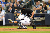Milwaukee Brewers catcher Jonathan Lucroy #20 and umpire Manny Gonzalez during a game against the Los Angeles Dodgers at Miller Park on May 22, 2013 in Milwaukee, Wisconsin.  Los Angeles defeated Milwaukee 9-2.  (Mike Janes/Four Seam Images)