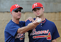 9 April 2008: Pitching coach Derek Botelho, left, instructs RHP Michael Nix of the Mississippi Braves, Class AA affiliate of the Atlanta Braves, prior to the season's home opener against the Mobile BayBears at Trustmark Park in Pearl, Miss. Photo by:  Tom Priddy/Four Seam Images