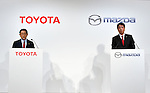 May 13, 2015, Tokyo, Japan - Presidents Akio Toyoda, left, of Toyota Motor Corp., speaks as Masamichi Kogai of Mazda Motor Corp. listens during a news conference at a Tokyo hotel on Wednesday, May 13, 20-15. Japans two automakers announced long-term partnership in technology in which Toyota will provide its fuel cell and plug-in hybrid technology in return for Mazda's proprietary Skyactive green technology. (Photo by Natsuki Sakai/AFLO)