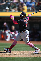OAKLAND, CA - MAY 12:  Carlos Santana #41 of the Cleveland Indians bats against the Oakland Athletics during the game at the Oakland Coliseum on Sunday, May 12, 2019 in Oakland, California. (Photo by Brad Mangin)