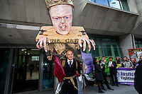 London, 05/05/2015. Today, the &quot;Justice Alliance&quot; and their Chris Grayling puppet dresses as King John Lackland held a &quot;farewell party&quot; outside the Ministry of Justice in Westminster to celebrate the last day of Chris Grayling as the British Minister of Justice. <br /> <br /> &quot;Stickers, Posters, Banners, Russell Brand, Occupy Statues, Class War&hellip; An Invisible Electoral Campaign&quot;.<br /> <br /> For more pictures and info about this event please click here: http://bit.ly/1H71ECg