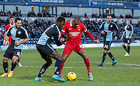 Jay Simpson of Leyton Orient & Aaron Pierre of Wycombe Wanderers in action during the Sky Bet League 2 match between Wycombe Wanderers and Leyton Orient at Adams Park, High Wycombe, England on 23 January 2016. Photo by Massimo Martino / PRiME Media Images.