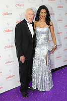Bruce Forsyth, Wilnelia Merced at the 2015 Butterfly Ball, in aid of the Caudwell Children Charity, at the Grosvenor House Hotel. <br /> June 25, 2015  London, UK<br /> Picture: James Smith / Featureflash