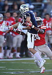 Nevada's Richy Turner (2) catches the ball while falling on UNLV's Fred Wilson (24) during the first half of an NCAA college football game in Reno, Nev., on Saturday, Oct. 26, 2013.<br /> (AP Photo/Cathleen Allison)