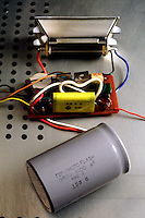 CAMERA FLASH CAPACITOR<br /> Interior elements of camera flash are extracted<br /> Capacitor is visible at the bottom