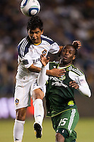 LA Galaxy starting defensive back A.J. DeLaGarza (20) beats Portland Timbers forward Jorge Perlaza (15) to a head ball. The LA Galaxy defeated the Portland Timbers 3-0 at Home Depot Center stadium in Carson, California on  April  23, 2011....