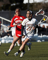 Boston College midfielder Caroline Margolis (21) on the attack. .Boston College (white) defeated Boston University (red), 12-9, on the Newton Campus Lacrosse Field at Boston College, on March 20, 2013.
