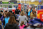 Local heroes shop with students for the 11th annual Holiday with a Hero at Walmart in Carson City, Nev., on Wednesday, Dec. 16, 2015. <br /> Photo by Cathleen Allison