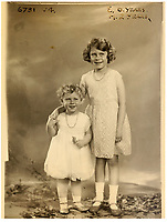 BNPS.co.uk (01202 558833)<br /> Pic: MarcusAdams/ChiswickAuctions/BNPS<br /> <br /> 1932 - Princess Elizabeth 6 years old and Princess Margaret aged 2.<br /> <br /> Charming childhood photos of Princess Elizabeth and Princess Margaret have come to light, including a previously unseen image of the future Queen in a kilt.<br /> <br /> The portraits, taken by acclaimed British society photographer Marcus Adams, capture the future Queen from being a baby to her adolescence.<br /> <br /> The Queen Mother would often take her daughters to his central London studio where he would set up toys and props to keep them entertained