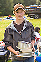 Teenagers from several different Seattle schools take part in a Youth Volunteer Corps project at Camp Sealth, on Vashon Island:  before puttng them away for the year, they are scrubbing the dishes, pots and pans used all summer at the camp.