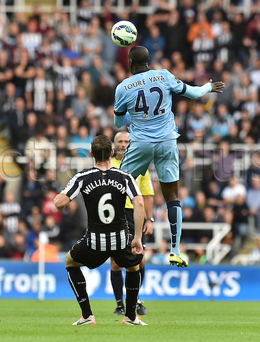17.08.2014.  Newcastle upon Tyne, England. Premier League. Newcastle United versus Manchester City. Manchester city midfielder Yaya Toure with the headser beating Williamson to the ball