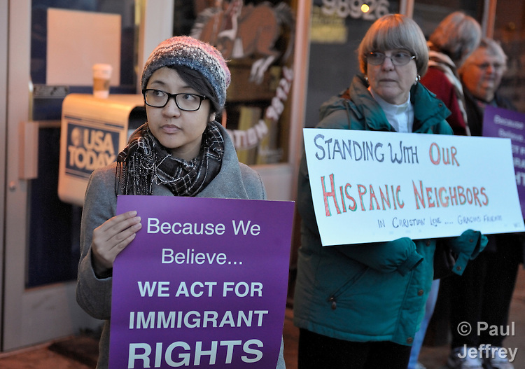 The Rev. Shalom Agtarap (left), pastor of First United Methodist Church in Ellensburg, Washington, participates in an ecumenical vigil on January 23, 2011, in support of dozens of local residents arrested for immigration-related violations by federal agents and local law enforcement officials on January 20, 2011. Churches in Ellensburg, a university town east of the Cascade Mountains, formed the nucleus of a local group organized to support the affected families. On the right is the Rev. Mary Johnson, a Lutheran pastor. The vigil took place at the local post office, the only federal building in Ellensburg.