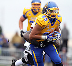 BROOKINGS, SD - OCTOBER 5:  Cam Jones #85 from South Dakota State University tries to shake the grasp of Bryan Presume #9 from Southern Illinois in the first quarter Saturday afternoon at Coughlin Alumni Stadium in Brookings. (Photo by Dave Eggen/Inertia)