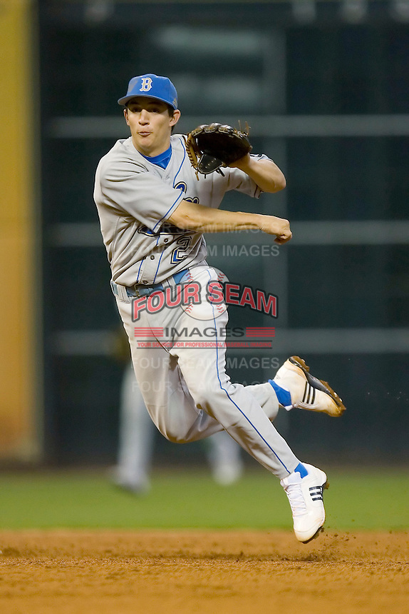 Shortstop Niko Gallego #2 of the UCLA Bruins follows through on a throw to first base versus the Rice Owls in the 2009 Houston College Classic at Minute Maid Park February 27, 2009 in Houston, TX.  The Owls defeated the Bruins 5-4 in 10 innings. (Photo by Brian Westerholt / Four Seam Images)