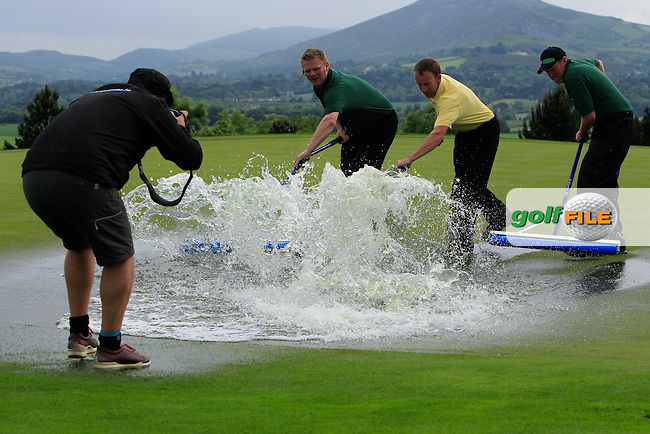 Groundsmen clearing the water logged 9th green during the suspension of play in the Saturday Afternoon Fourballs of the 2016 Curtis Cup at Dun Laoghaire Golf Club on Saturday 11th June 2016.<br />