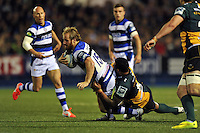 Nick Abendanon is tackled to ground. Amlin Challenge Cup Final, between Bath Rugby and Northampton Saints on May 23, 2014 at the Cardiff Arms Park in Cardiff, Wales. Photo by: Patrick Khachfe / Onside Images