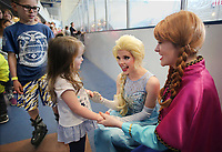 NWA Democrat-Gazette/DAVID GOTTSCHALK  Jaxson Payne (from left), 11, watches his cousin Blakeleigh Sisson, 3, visit Friday, March 23, 2018, with Crystal Skahan and Kellie Gurwell, with NWA Princess Parties, as they portray the animated movie characters Elsa and Anna at the Jones Center in Springdale. The two princesses were part of the Frozen Friday skating Spring Break Week 2018 event at at the center.