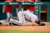Syracuse Chiefs third baseman Jacob Wilson (19) collapses to the ground after getting hit in the head by pitcher Sean Reid-Foley (not shown) during a game against the Buffalo Bisons on July 6, 2018 at Coca-Cola Field in Buffalo, New York.  Buffalo defeated Syracuse 6-4.  (Mike Janes/Four Seam Images)