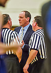 4 February 2014: University of Vermont Catamount Head Coach John Becker chats with officials during a game against the University of Maine Black Bears at Patrick Gymnasium in Burlington, Vermont. The Cats defeated the Bears 93-65 improving to 9-1 in America East and 15-9 overall. Mandatory Credit: Ed Wolfstein Photo *** RAW (NEF) Image File Available ***