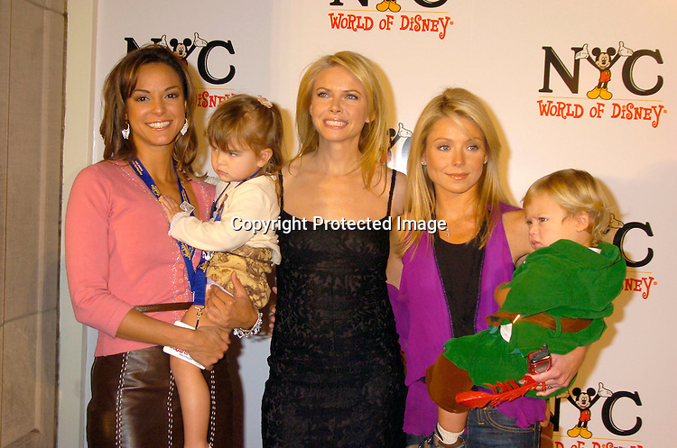 Eva La Rue, Kaya Callahan, Faith Ford, Kelly Ripa and Joaquin Consuelos..at the World of Disney Store opening on October 4, 2004 ..on Fifth Avenue in New York City. Photo by Robin Platzer, Twin Images