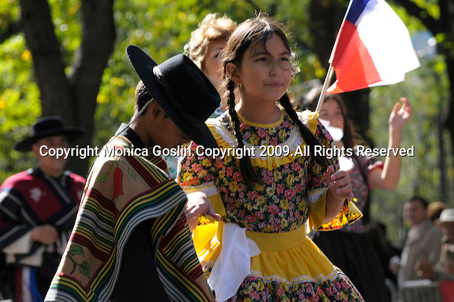 The Hispanic Parade in New York City. A boy and girl wearing traditional clothes and representing Chile in the Hispanic Parade in New York City.