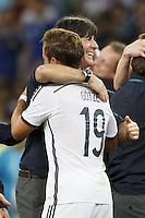 Mario Gotze celebrates with Germany manager Joachim Low