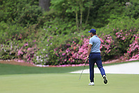 Brooks Koepka (USA) fist pumps his eagle putt on the 13th green during the final round at the The Masters , Augusta National, Augusta, Georgia, USA. 14/04/2019.<br /> Picture Fran Caffrey / Golffile.ie<br /> <br /> All photo usage must carry mandatory copyright credit (© Golffile | Fran Caffrey)