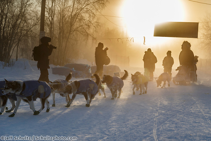 Scott Smith arrives and checks in at 40 below zero with ice fog in the morning at the Huslia checkpoint on Saturday  March 14, 2015 during Iditarod 2015.  <br /> <br /> (C) Jeff Schultz/SchultzPhoto.com - ALL RIGHTS RESERVED<br />  DUPLICATION  PROHIBITED  WITHOUT  PERMISSION
